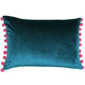 rectangular teal blue cushion with pink pom poms on the short sides of the cushion