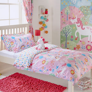 Bright pink duvet set from Little Big Cloud featuring fun patterns and illustrations of little characters (including unicorns!) and flowers. The reverse of the set has a colourful star print
