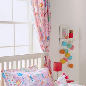 Bright pink curtains from Little Big Cloud featuring fun patterns and illustrations of little characters (including unicorns!) and flowers.