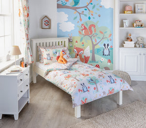 duvet set featuring fun & colourful woodland illustrations & a bright plant print reverse