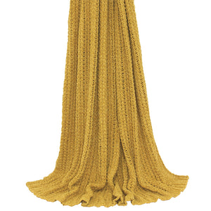 ochre yellow knit throw draping from above