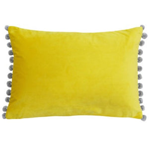 Rectangular cushion in a beautiful yellow colour with silver pom pom trim.