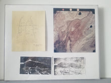 A photo of the entire piece, which is encased in an acrylic case. It features a first edition original aviation assisted photo, a print of a hand drawn map from October 4th, 1971, and two smaller prints depicting the area throughout development.