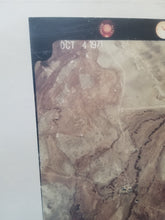 "This is a close up image of the front of the photograph taken from an airplane and clearly visible is a date reading: ""Oct 4, 1971"""
