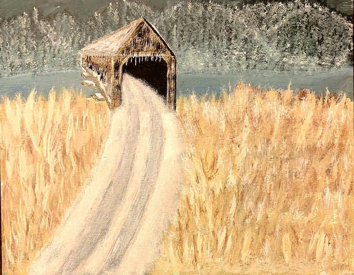An autumn amber field of grain gathers around an old wooden barn bridge with a narrow gravel or dirt road leading into the architecture accumulating ice.