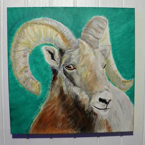 A square photograph of a square painting of a superb specimen of ram. This bust of a bighorned sheep is shown on a subtle green background. It peers at viewers skeptically from his position in the foreground. The painting itself is hung on a pristine wall fit for the eyes of royalty.