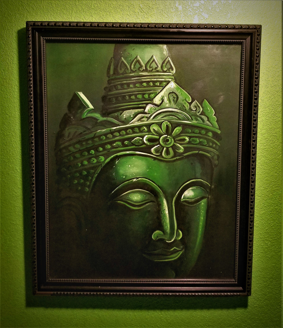 A rectangular painting with an emerald colored head bearing a resembelence to the religous figure, Buddha with a black background and black frame.