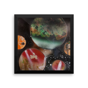 This square spray paint picture has a black frame and portrays planets in a ring- five in total. The largest in the back center resembles Earth in color scheme, while the rest are shades of red and orange.