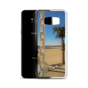 A weird winter wonderland is portrayed within this print put on a phone case. Made for one of many Samsung smartphones, you see a palm tree siting in the background of a frosted tropical area. In the foreground of this photo, an ice covered chain dangles coldly in contrast. From behind the very phone case itself, a Samsung S8 peeks out to represent eternity in its entirety.