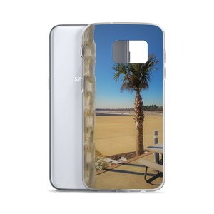 A weird winter wonderland is portrayed within this print put on a phone case. Made for one of many Samsung smartphones, you see a palm tree siting in the background of a frosted tropical area. In the foreground of this photo, an ice covered chain dangles coldly in contrast. From behind the very phone case itself, a Samsung S9 peeks out to represent eternity.