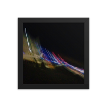 A black background on a square picture with warped, multicolored lights running top left of picture diagonally down to bottom right.