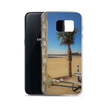 A weird winter wonderland is portrayed within this print put on a phone case. Made for one of many Samsung smartphones, you see a palm tree siting in the background of a frosted tropical area. In the foreground of this photo, an ice covered chain dangles coldly in contrast.
