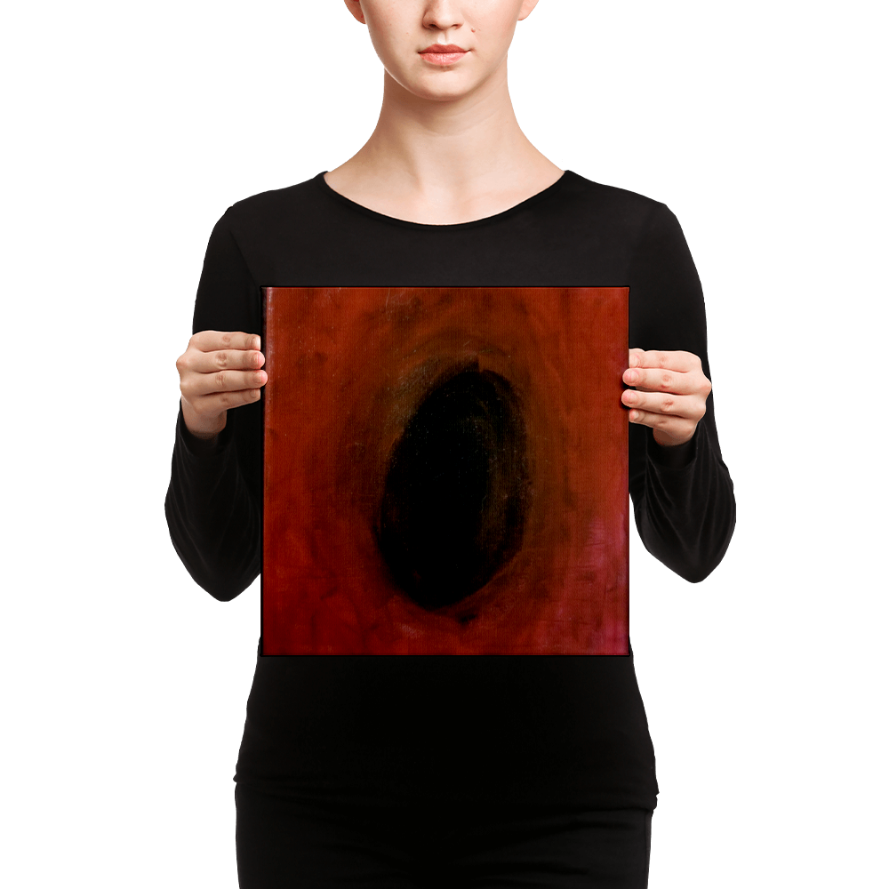 An eyeless model stands with a blank smile while holding a vertically rectangular canvas print of Andrew Aaron's Remis Iris. The piece showcases an abyss of red and black as it centers on the infinite chasm of eternity.