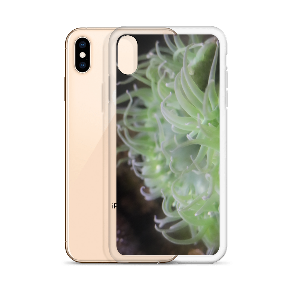 Imagine a sleek cellphone case of hard plastic wrapped around an iPhone. This phone case is smooth and has a photo of an anemone that's neon green tentacles dance playfully in the ocean.  Photograph taken by trending artist Andrew Aaron.