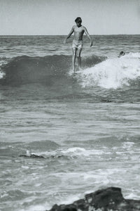 A young Wayne Lynch nose-rides at Lorne Point