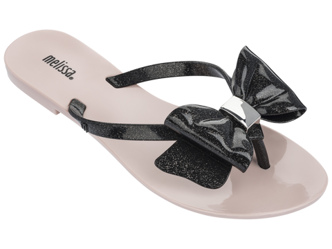 Melissa Women's pink jelly flip flops with black strap and bow