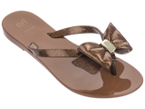 Melissa Kid's brown jelly flip flops with bow