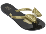 Melissa Kid's black and gold jelly flip flops with bow