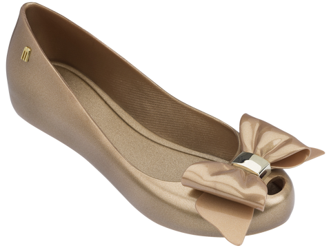 Melissa Kid's gold jelly flats with bow