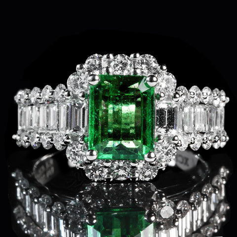 A traditional emerald and diamond dinner ring.