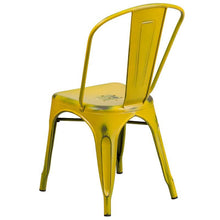 Load image into Gallery viewer, Distressed Yellow Metal Indoor-Outdoor Stackable Chair