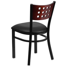 Load image into Gallery viewer, HERCULES Series Black Cutout Back Metal Restaurant Chair - Mahogany Wood Back, Black Vinyl Seat