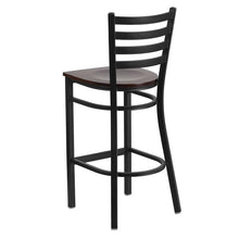 Load image into Gallery viewer, HERCULES Series Black Ladder Back Metal Restaurant Barstool - Walnut Wood Seat