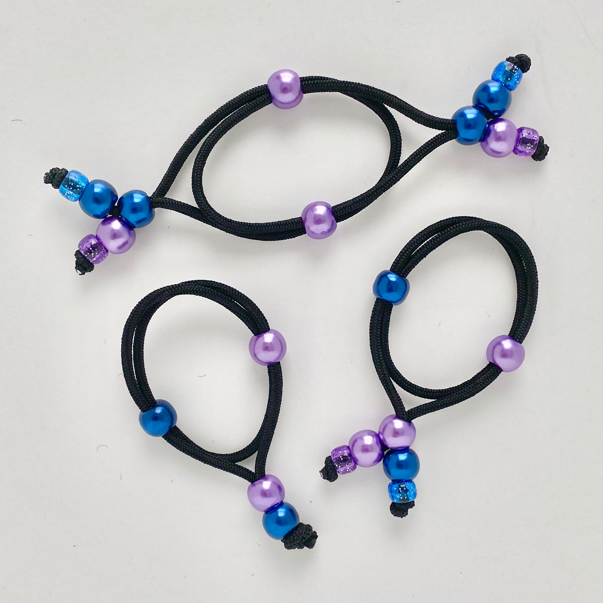 Our hair ties make perfect ponytails and hair buns quickly and easily.  Our hair ties are comfortable and they create a secure hold for all hair types.  Our hair ties won't stretch out, break or damage your hair.