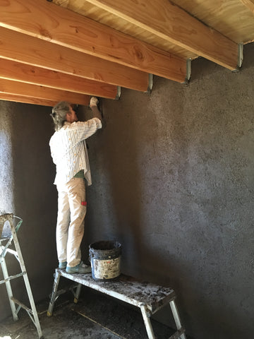 applying earthen plaster
