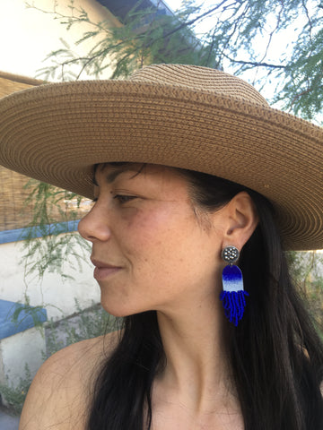 beaded earrings and a sun hat