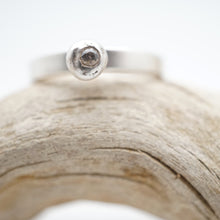 silver bead ring with white sapphire
