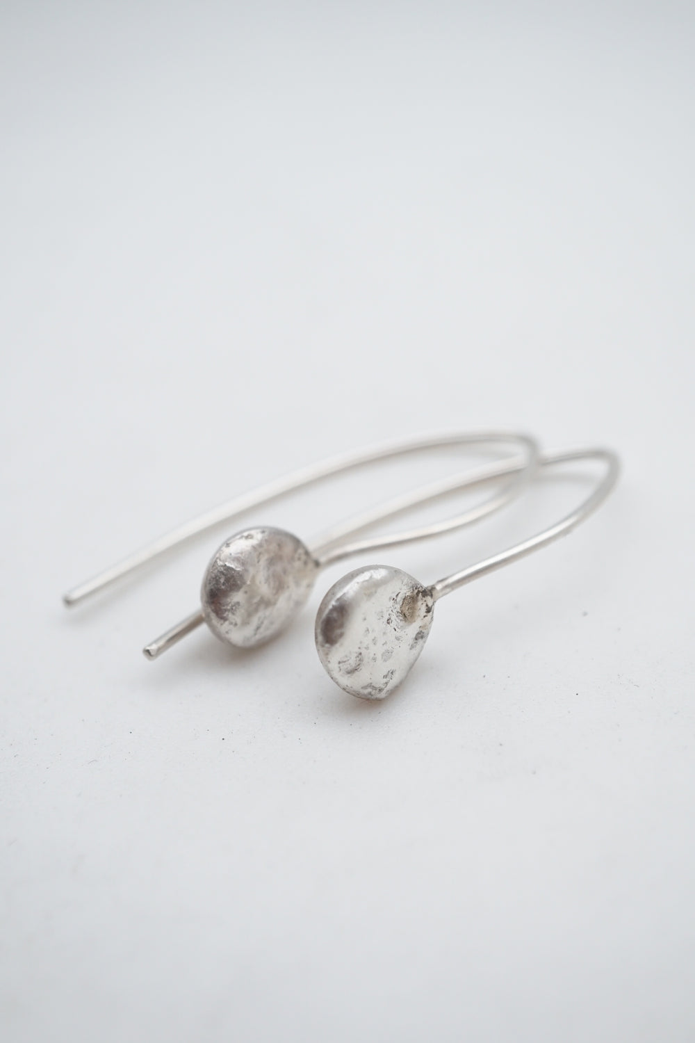 liquid silver single drop dangle earrings