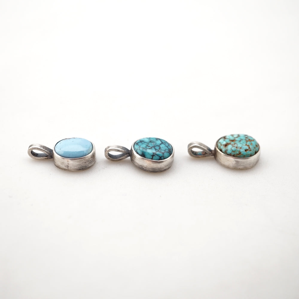 high grade turquoise pebble charms - no chain included