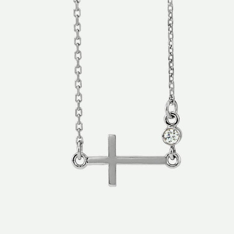 Front view of white gold Sideways Cross Christian necklace for women