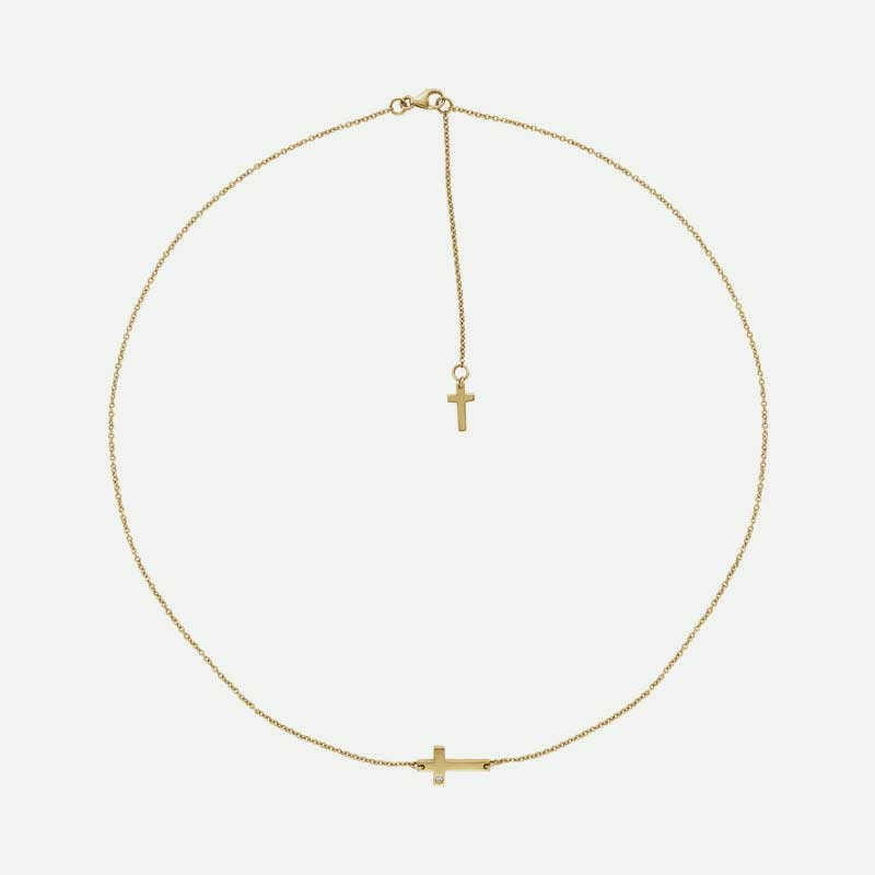 Top view of yellow gold Sideways Cross Christian necklace for women