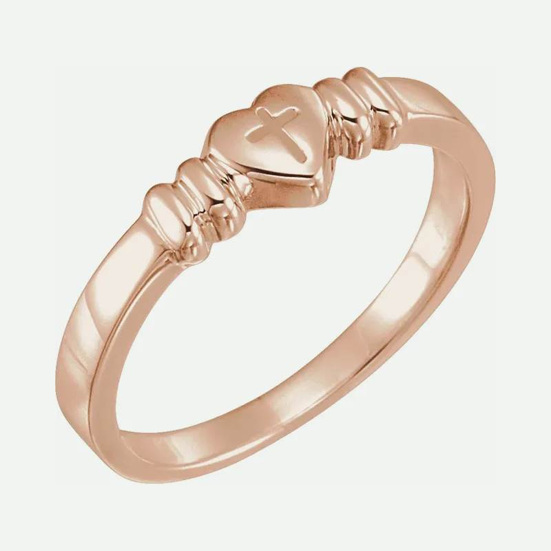 Oblique view of rose gold HEART AND CROSS Christian Ring for women