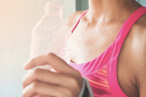 woman with water bottle after a workout