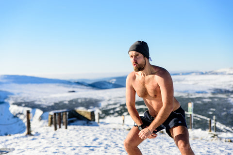 Iceman Wim Hoff Method Outside In the Snow on mountain Cold in beanie hat