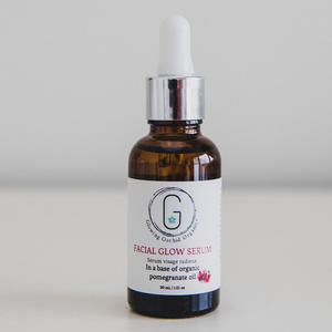 Evening Glow Facial Serum Glowing Orchid Organics 30 ml | 1.01 oz Vegan Cruelty Free with Pomegranate seed oil in Amber bottle with silver Dropper