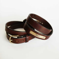 stitched brown nameplate belt
