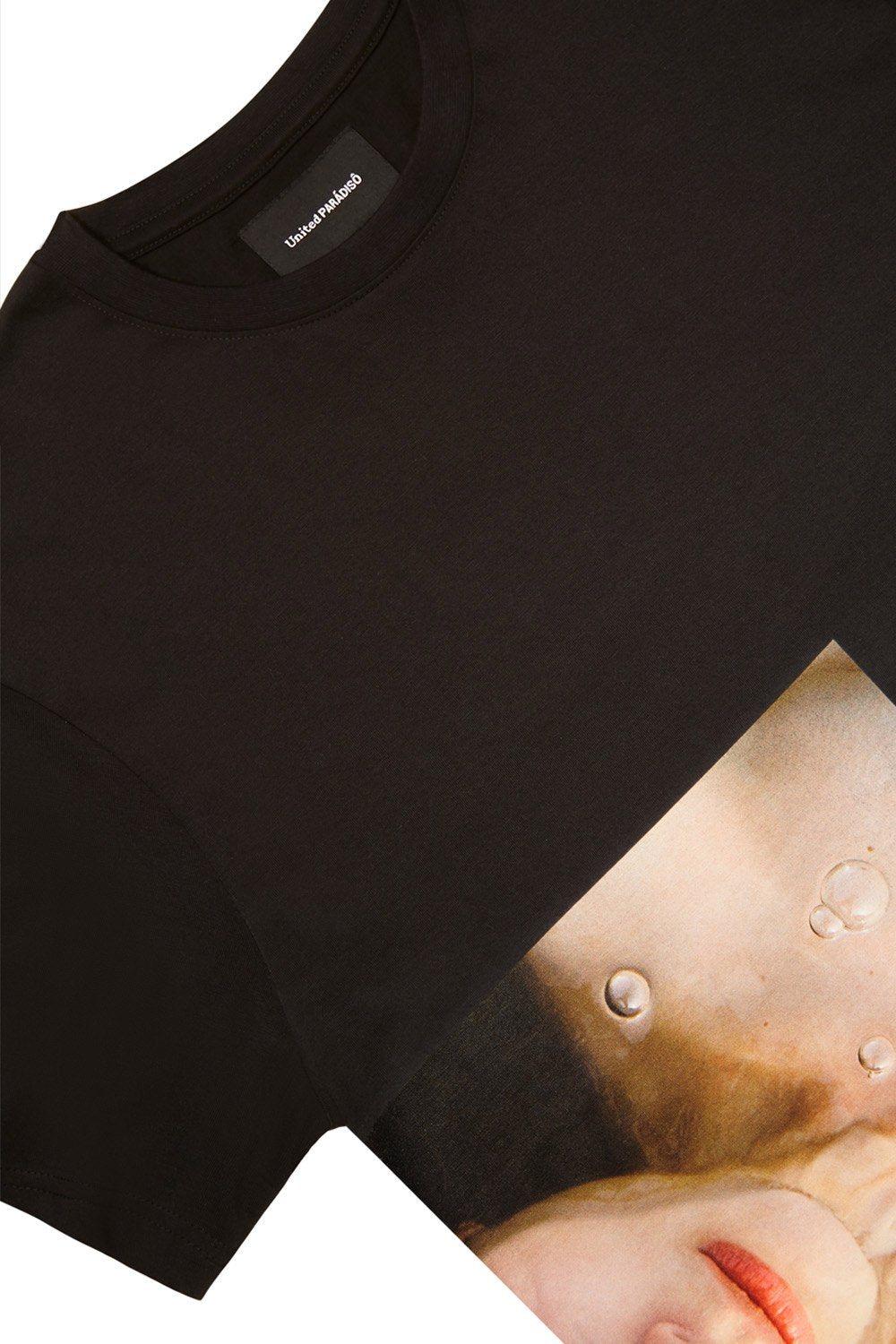 Load image into Gallery viewer, Paradiso Black Larissa Short-Sleeved Supima Charity T-Shirt Thomas Lohr Front Detail
