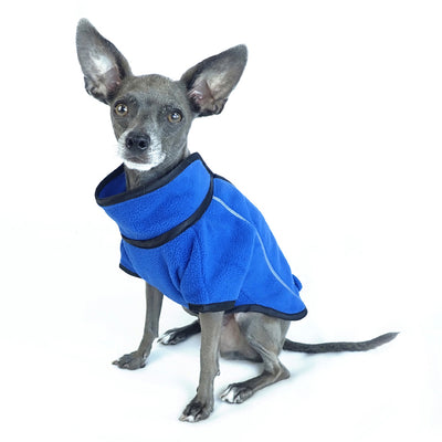 athletic style blue fleece dog jacket front side view on sitting dog