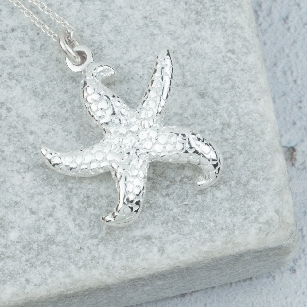 silver starfish necklace detailed