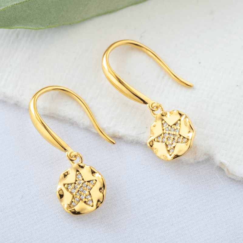 gold star earrings with stones