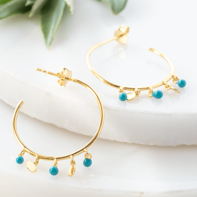 hoop earrings with beads in gold