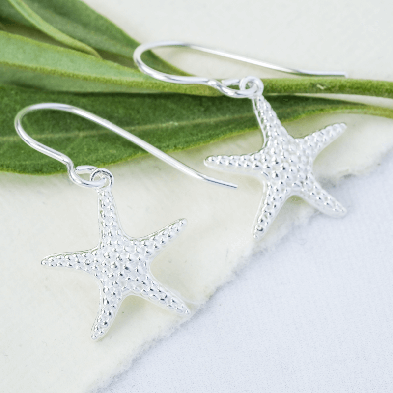 starfish earrings on hook in silver