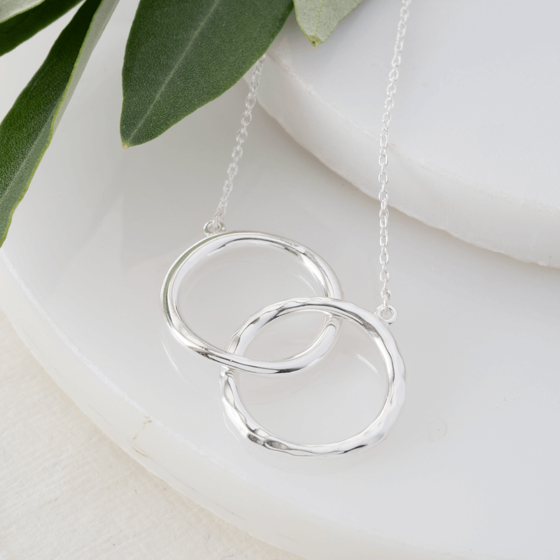 silver necklace two interlocked rings on a chain