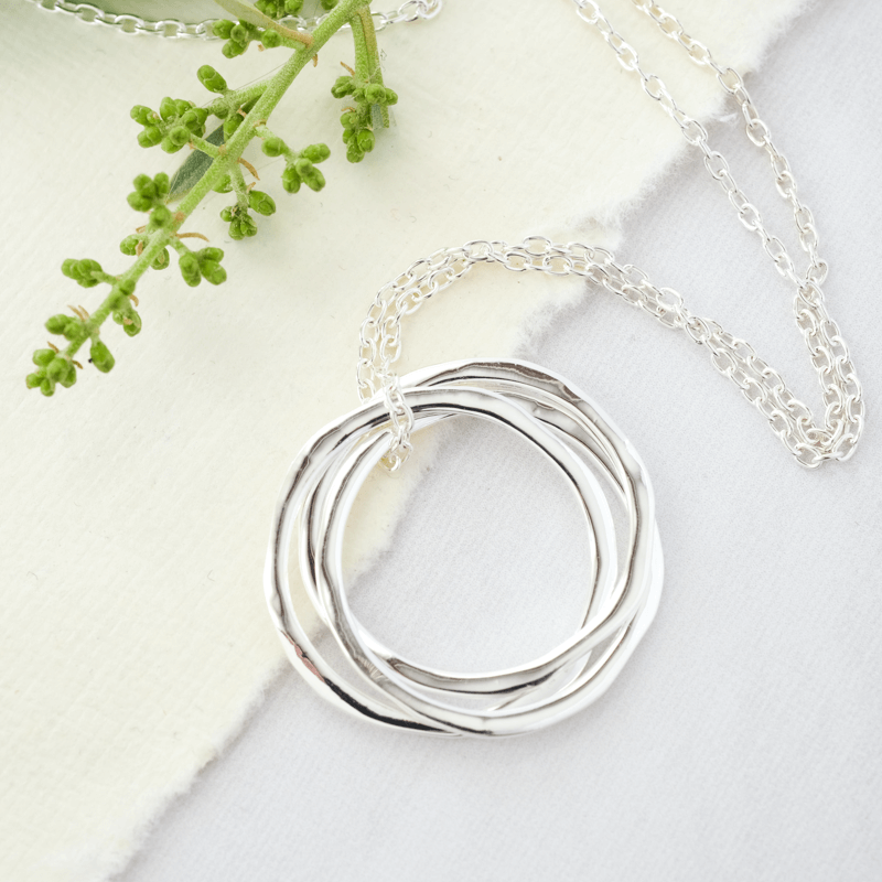 silver necklace uneven hoops