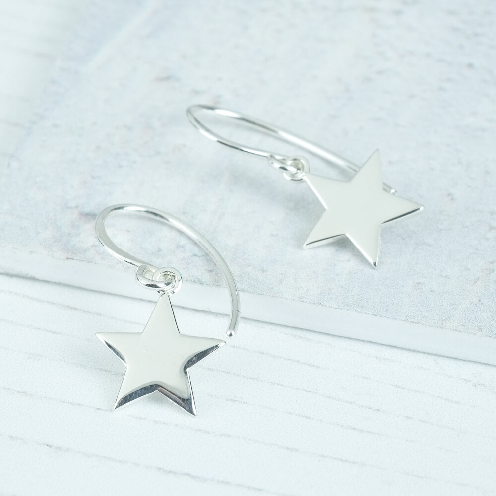 star earrings on a hook