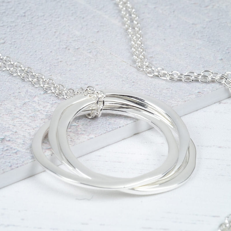 Silver pendant on long chain